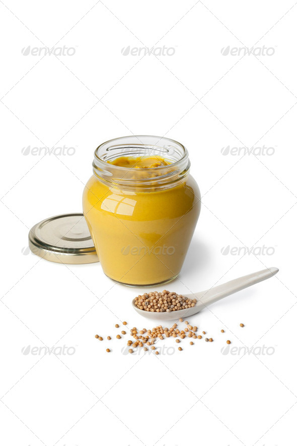 Mustard in a jar and mustard seeds - Stock Photo - Images