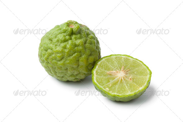 Whole and half Kaffir lime - Stock Photo - Images