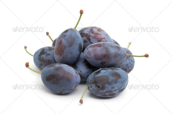 Whole fresh Damson plums - Stock Photo - Images