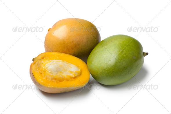 Whole and half Mango - Stock Photo - Images