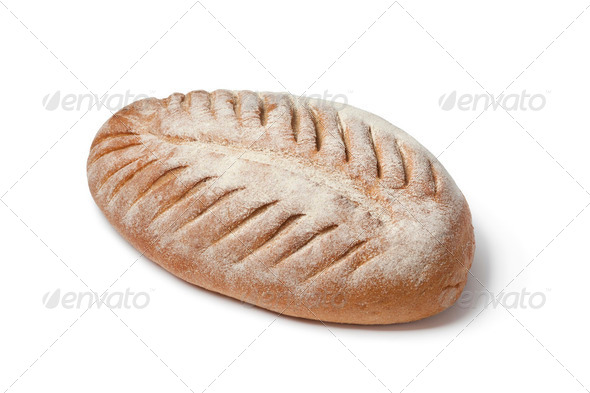Loaf of French farmers bread with slices - Stock Photo - Images