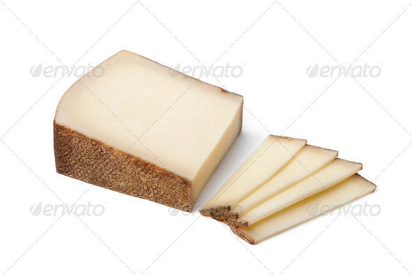 Piece of Swiss Gruyere cheese ans slices - Stock Photo - Images