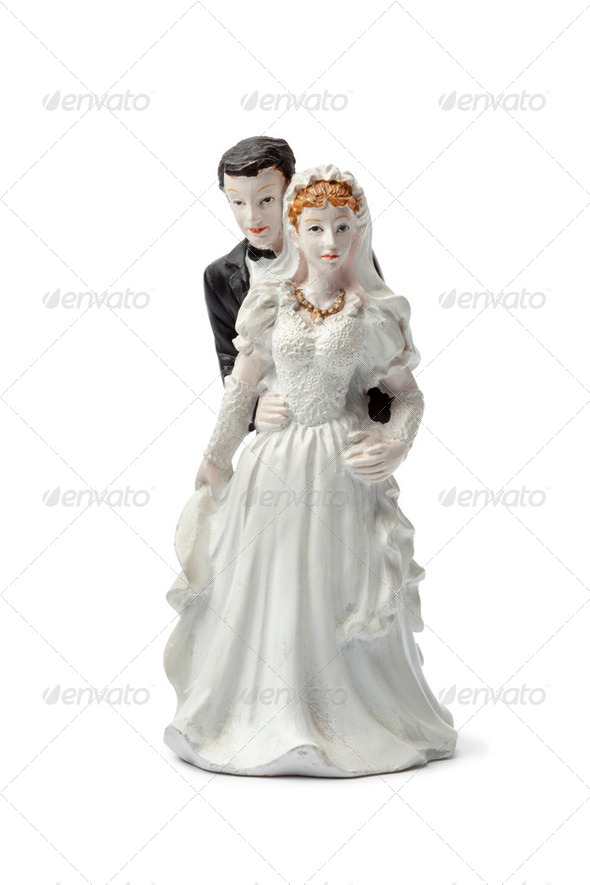 Old plaster bride and groom cake topper isolated on white back - Stock Photo - Images