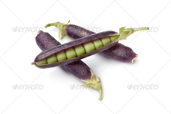 Fresh peas in purple pod - Stock Photo - Images