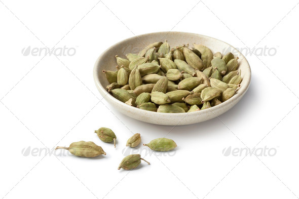 Cardamom seeds on a small dish - Stock Photo - Images