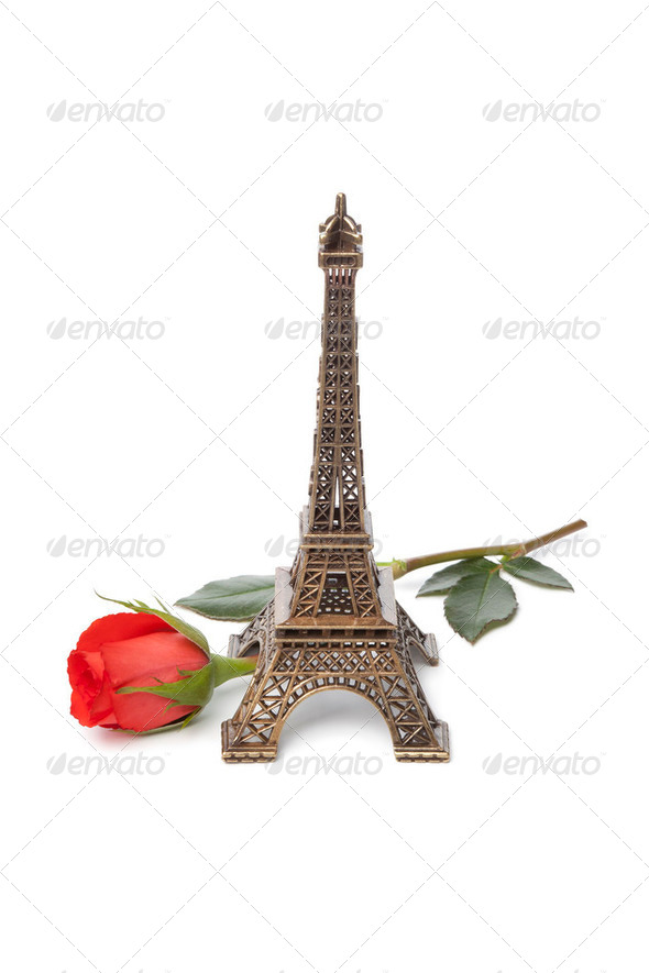 Eiffel tower souvenir with a red rose - Stock Photo - Images