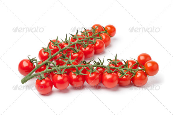 Small cherry tomatoes on a vine - Stock Photo - Images