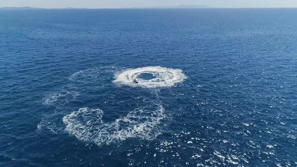 Aerial View Shot Of A Person Jet Skiing In Circles Beautiful