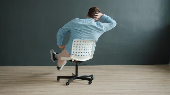 Smiling Guy Spinning On Office Chair