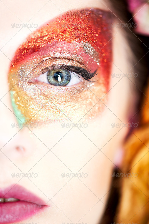 beauty makeup portrait of half a face of a young woman, with an - Stock Photo - Images