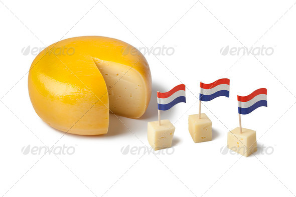 Gouda cheese with dutch flags - Stock Photo - Images