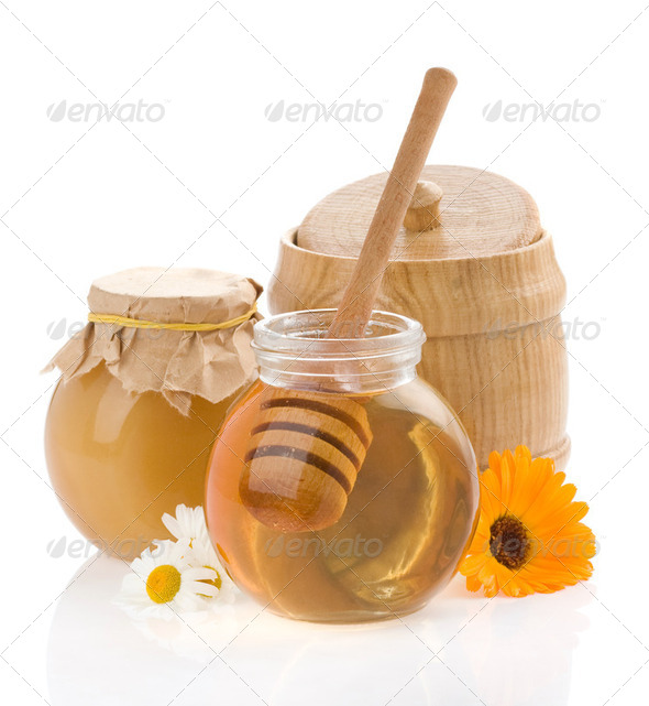 honey and flowers isolated on white - Stock Photo - Images