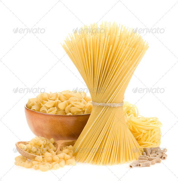 pasta and wooden plate on white - Stock Photo - Images