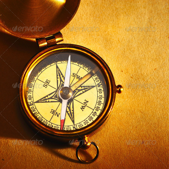 Antique brass compass over old background - Stock Photo - Images