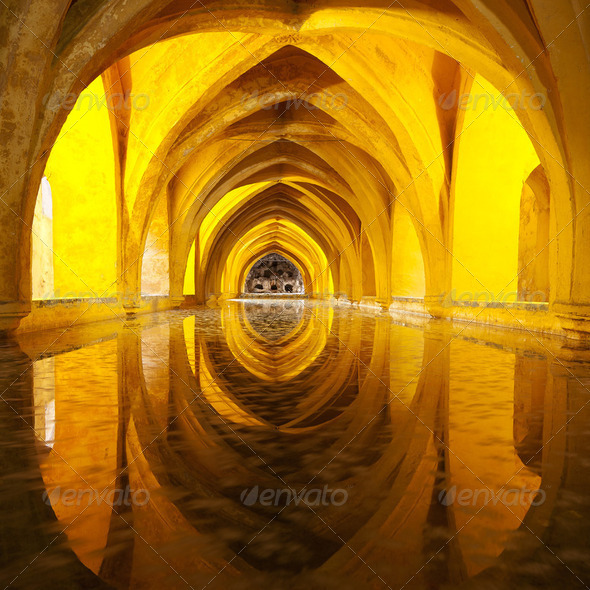 Alcazar queen bath, front view Seville, Andalusia, Spain - Stock Photo - Images