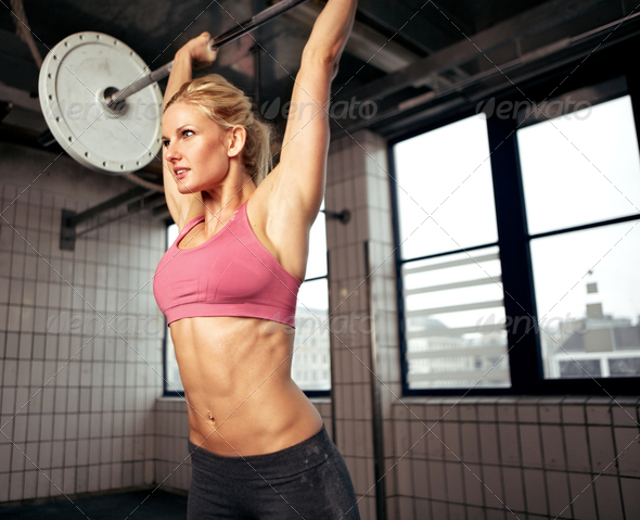 Woman Lifting Weight - Stock Photo - Images