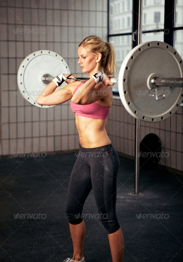 Fitness Woman Lifting Heavy Weight - Stock Photo - Images