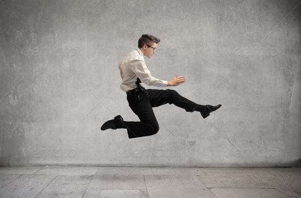 Young Businessman Jump - Stock Photo - Images