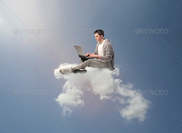 Laptop on a Cloud - Stock Photo - Images