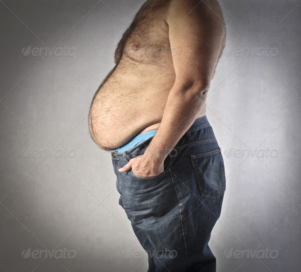 Fat Man in Jeans - Stock Photo - Images