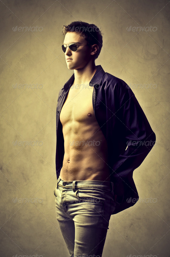 Young man with the shirt opened posing - Stock Photo - Images
