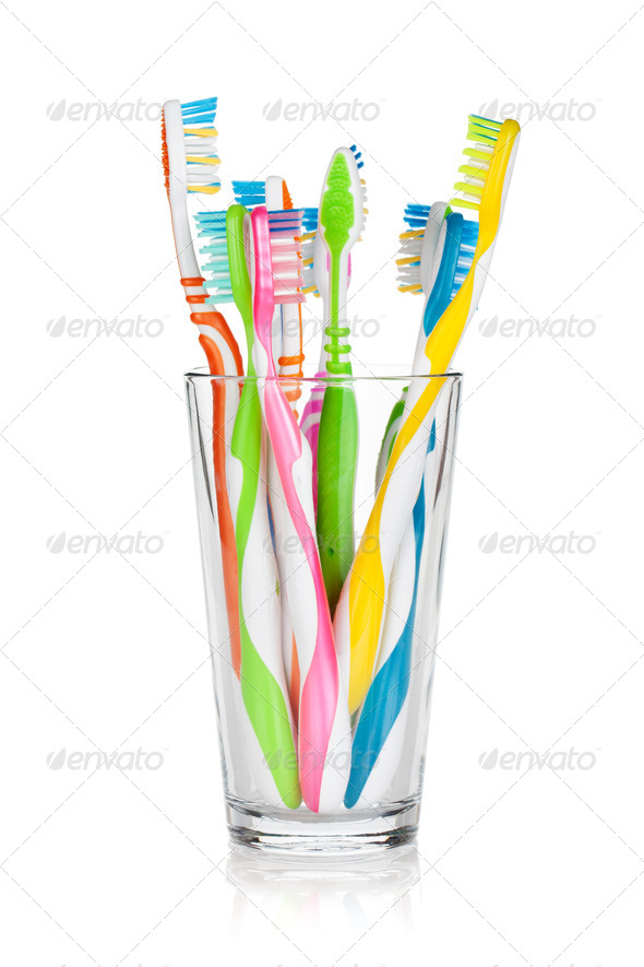 Colorful toothbrushes in glass - Stock Photo - Images