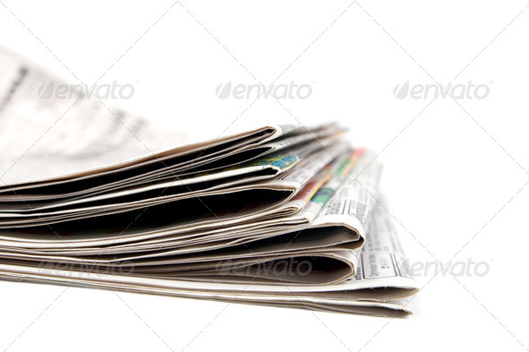Stack of newspapers. - Stock Photo - Images