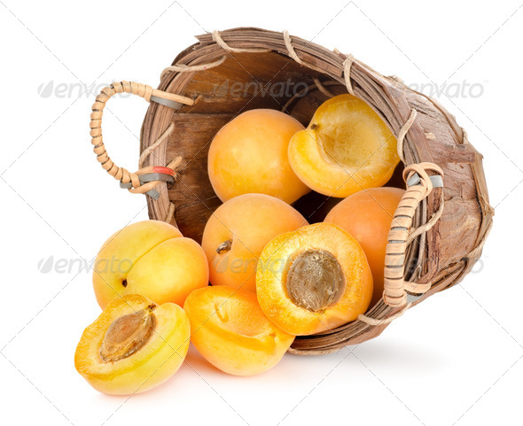 Ripe apricots in a wooden basket - Stock Photo - Images