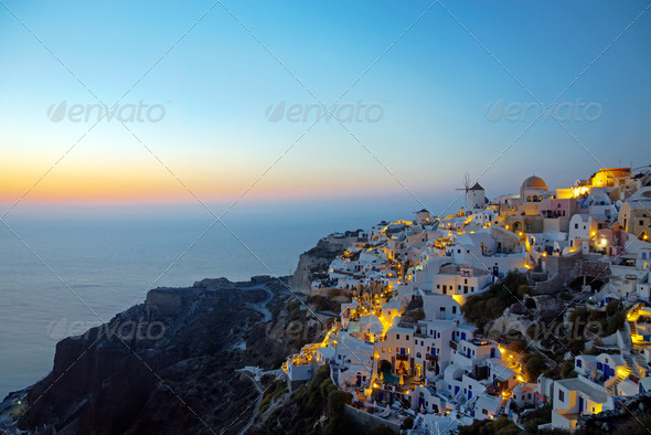 Oia village on santorini island at dawn  - Stock Photo - Images