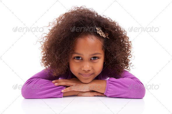 Cute little African Asian girl lying down on the floor - Stock Photo - Images