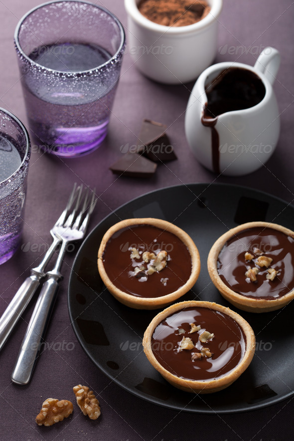 tartelettes with chocolate ganache and walnuts - Stock Photo - Images