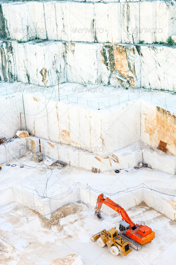 White marble quarry and excavators. Carrara, Italy - Stock Photo - Images