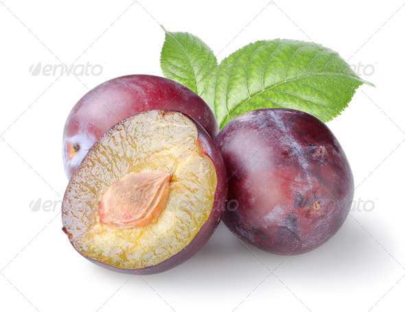 Three plums with leaves - Stock Photo - Images