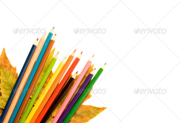 Color pencil with autumnal leaf. - Stock Photo - Images