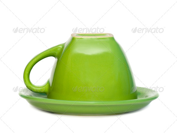 Green inverted cup on a saucer. Isolated on white background. - Stock Photo - Images
