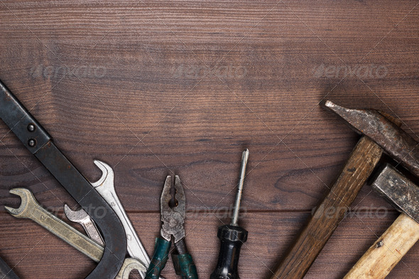 Rusty Construction Tools On The Wooden Background - Stock Photo - Images