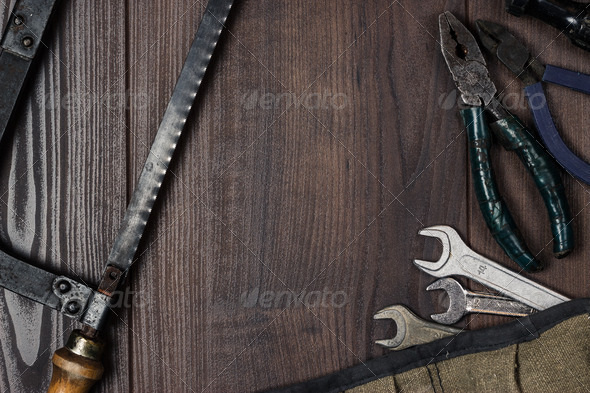 Rusty Construction Instruments On The Wooden Background - Stock Photo - Images