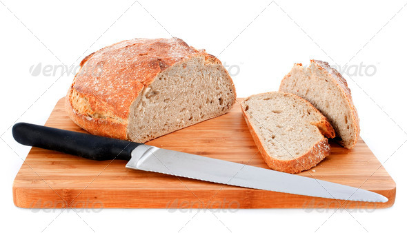 loaf of bread and knife - Stock Photo - Images