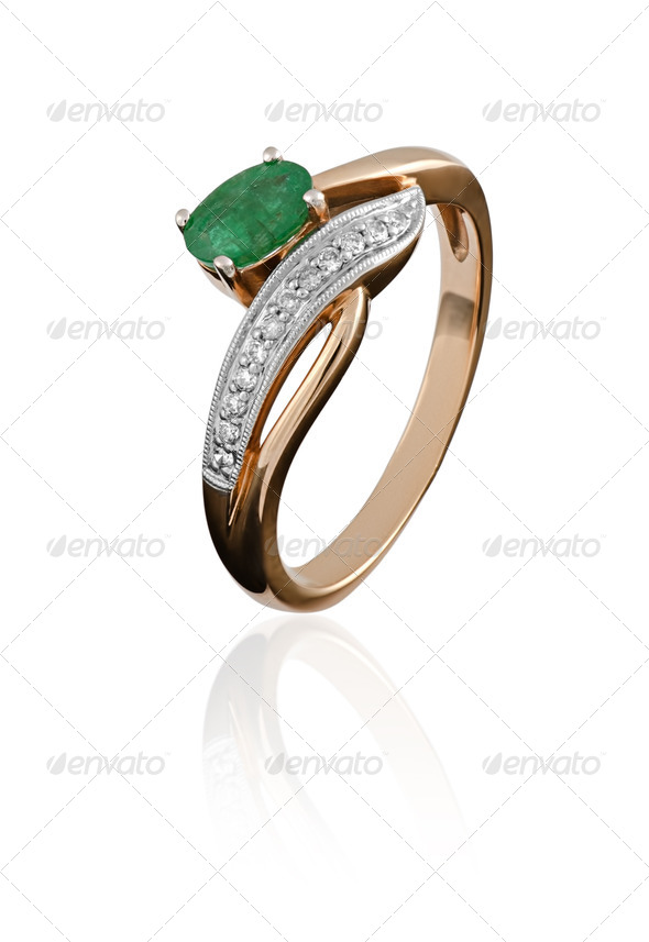 gold ring with an emerald - Stock Photo - Images