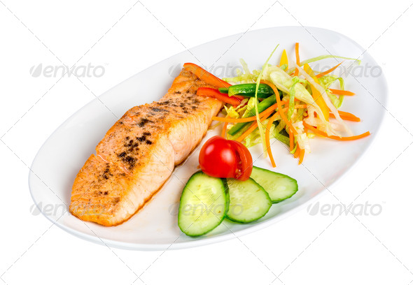 Tasty fillet of a salmon on a white - Stock Photo - Images