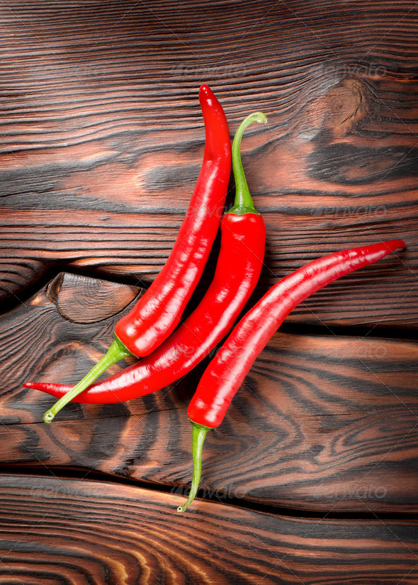 Chili on a wooden background - Stock Photo - Images