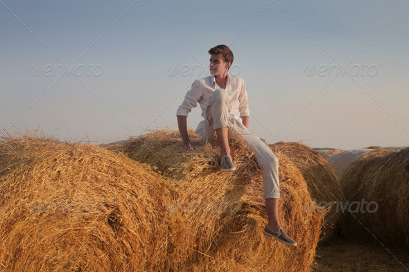 Sitting on the Sheaves - Stock Photo - Images