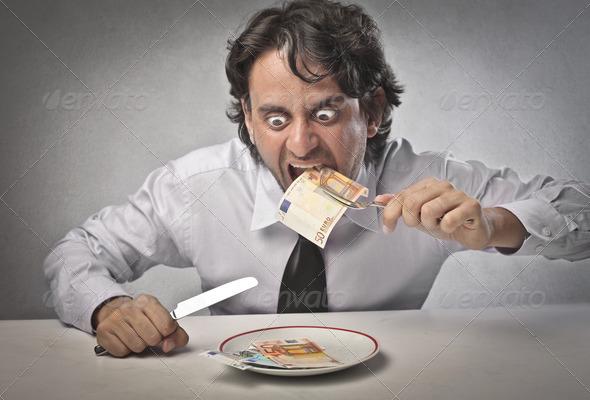 Eating Money - Stock Photo - Images