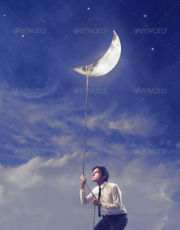 Holding the Moon - Stock Photo - Images