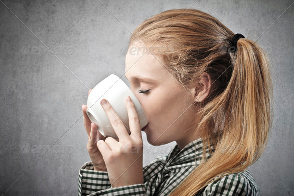 Sipping Cup of Tea - Stock Photo - Images