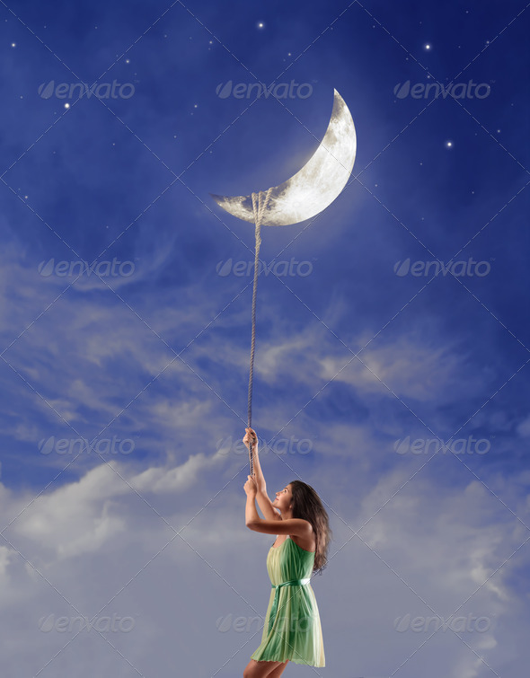 Girl Holding the Moon - Stock Photo - Images