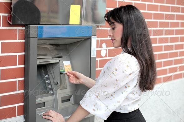 Woman at the Bancomat - Stock Photo - Images