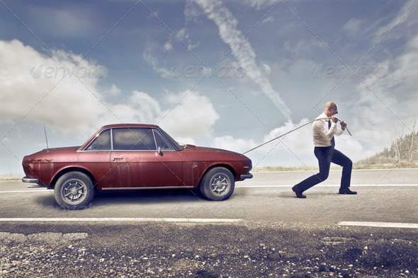 Pulling a Car - Stock Photo - Images