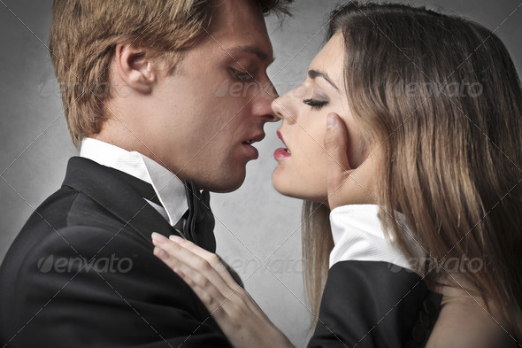 Young Newlyweds Kiss - Stock Photo - Images