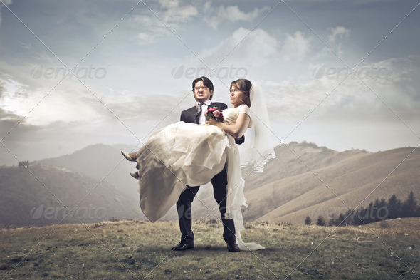 Newlyweds on a Hill - Stock Photo - Images